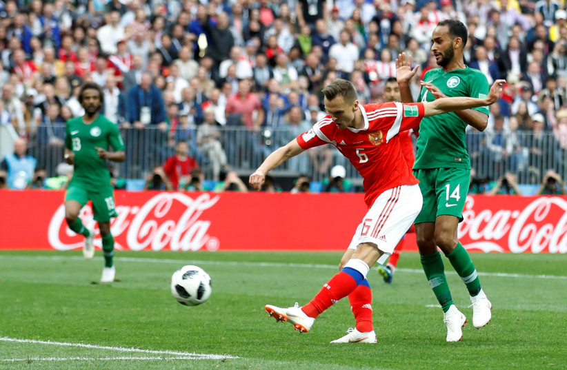 RUSSIA'S DENIS Cheryshev scores their second goal in the the Russia vs Saudi Arabia World Cup match on June 14 in Moscow's Luzhniki Stadium (photo credit: REUTERS)