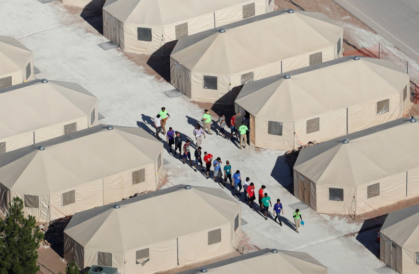 """Immigrant children, many of whom have been separated from their parents under a new """"zero tolerance"""" policy by the Trump administration, are being housed in tents next to the Mexican border in Tornillo, Texas, U.S. June 18, 2018. (photo credit: REUTERS/MIKE BLAKE)"""