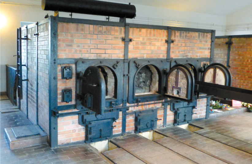 THE CREMATORIUM in Buchenwald. The Topf logo can be seen on the machines, now part of a museum at the site (photo credit: Wikimedia Commons)