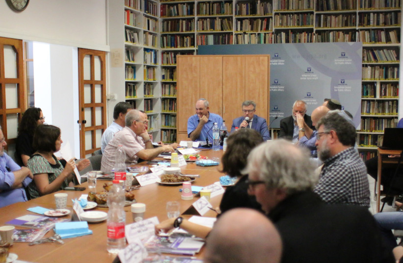 PARTICPANTS IN A roundtable discussion gather this week at the Jerusalem Center for Public Affairs, June 21, 2018.  (photo credit: ROCKY BAIER)