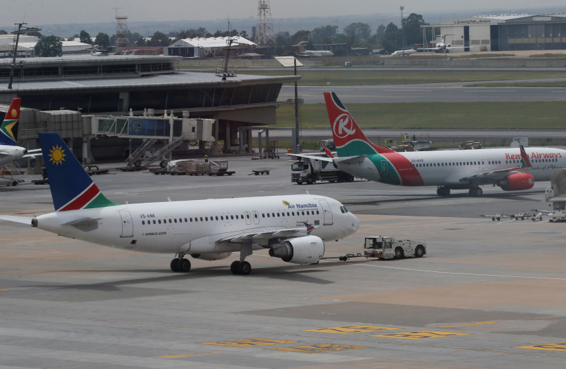 DATE IMPORTED: March 10, 2017 Air Namibia (L) and Kenya Airways aircraft are parked at the OR Tambo International Airport in Johannesburg, South Africa (photo credit: SIPHIWE SIBEKO/REUTERS)