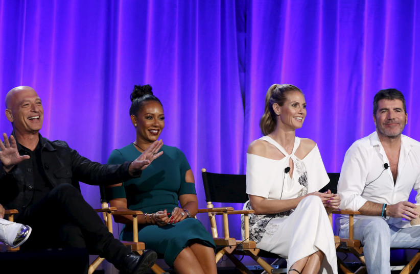 """Howie Mandel, Melanie Brown, Heidi Klum and Simon Cowell attend a panel for the television show """"America's Got Talent"""" (photo credit: MARIO ANZUONI/REUTERS)"""