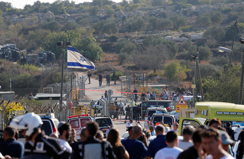 Israeli security at the scene where a Palestinian terrorist opened fire on Israelis at the Har Adar settlement, outside of Jerusalem, Sept. 26, 2017. (photo credit: AMMAR AWAD / REUTERS)