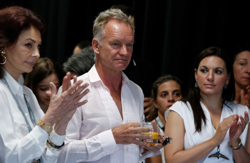 British singer Sting attends an event organized by Amnesty International and the Athens International Airport in Athens, Greece, June 23, 2018.  (photo credit: COSTAS BALTAS / REUTERS)