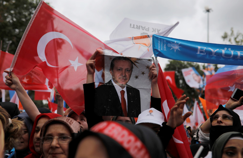 Supporters of Turkish President Tayyip Erdogan attend his election rally in Istanbul, Turkey, June 23, 2018 (photo credit: ALKIS KONSTANTINIDIS / REUTERS)