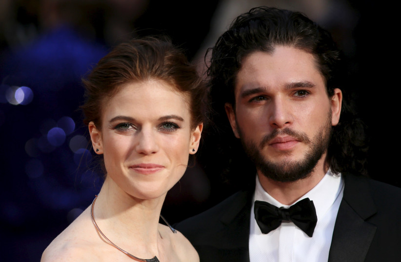 Actor Kit Harington (R) and actress Rose Leslie (L) pose for photographers as they arrive at the Olivier Awards at the Royal Opera House in London, Britain April 3, 2016. (photo credit: NEIL HALL/REUTERS)