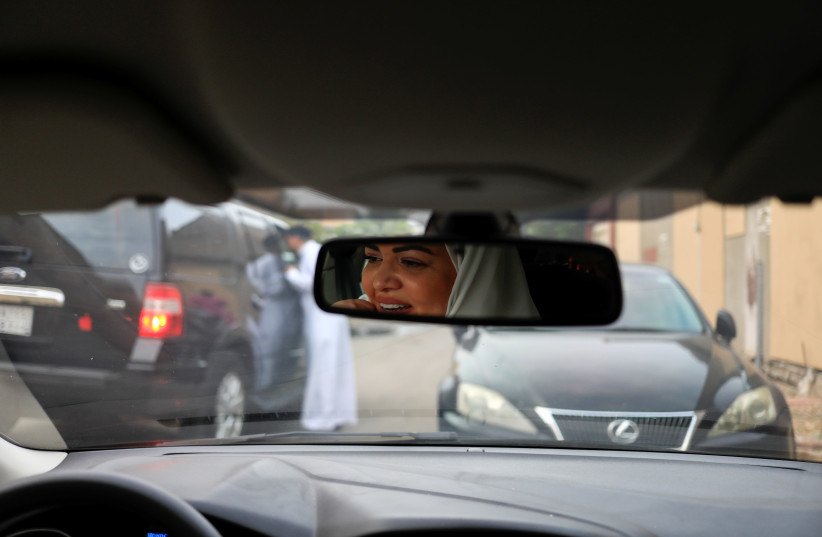 Dr Samira al-Ghamdi, 47, a practicing psychologist, drives around the side roads of a neighborhood as she prepares to hit the road as a licensed driver (photo credit: ZOHRA BENSEMRA/REUTERS)