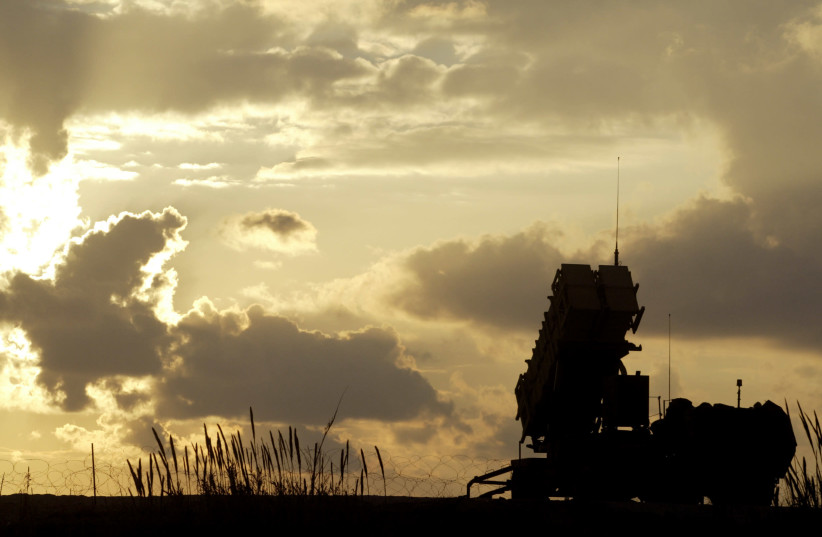 A Patriot anti-missile system deployed in a joint U.S. and Israeli military outpost in Jaffa, south of Tel Aviv is silhouetted against the setting sun (photo credit: NIR ELIAS / REUTERS)
