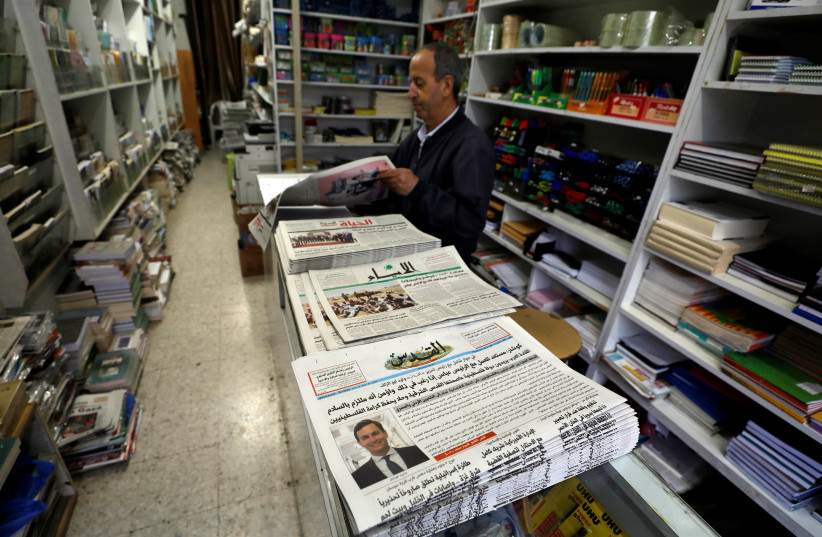 The Palestinian newspaper Al Quds that published an interview with Jared Kushner, U.S. President Donald Trump's senior adviser, is displayed for sale in a bookshop in Ramallah in the occupied West Bank, June 24, 2018. (photo credit: MOHAMAD TOROKMAN/REUTERS)