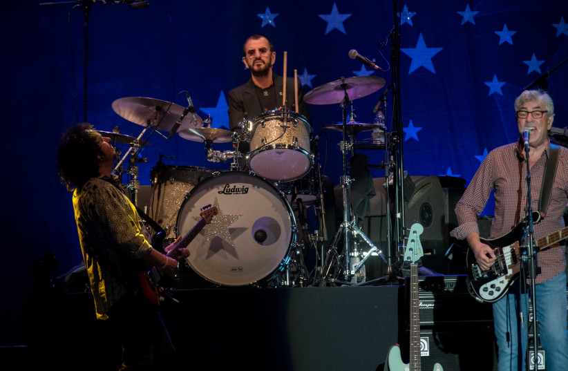 Ringo Starr performs in Tel Aviv with Steve Lukather (left) and Graham Gouldman. (photo credit: LIOR KETER)