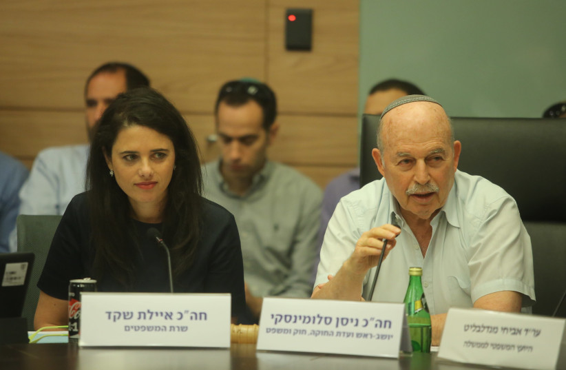 Justice Minister Ayelet Shaked and Knesset Member Nissan Slomiansky debate in a ministerial committee meeting on Monday, June 25, 2018 (photo credit: MARC ISRAEL SELLEM)