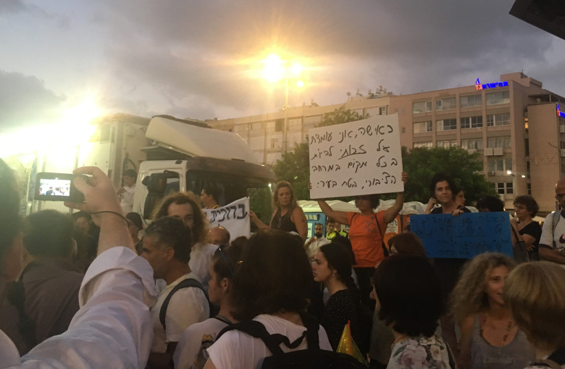 DEMONSTRATORS PROTEST the segregation of genders at a Chabad event in Rabin Square in Tel Aviv, June 25, 2018 (photo credit: NAOMI GRANT)