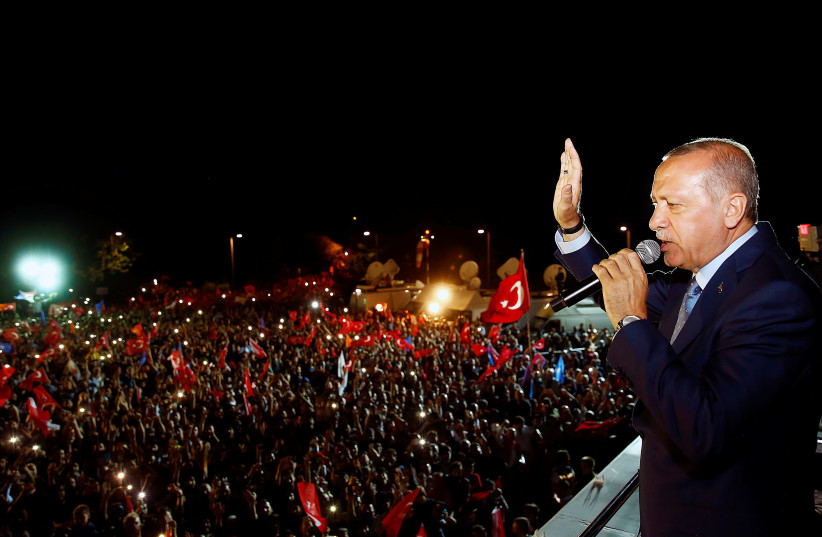 Turkish President Tayyip Erdogan addresses his supporters in Istanbul, Turkey June 24, 2018 (photo credit: KAYHAN OZER/PRESIDENTIAL PALACE/HANDOUT VIA REUTERS)