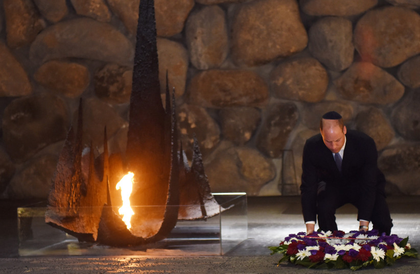 Britain's Prince William lays a wreath during a ceremony commemorating the six million Jews killed by the Nazis in the Holocaust, in the Hall of Remembrance at Yad Vashem (photo credit: DEBBIE HILL/REUTERS)