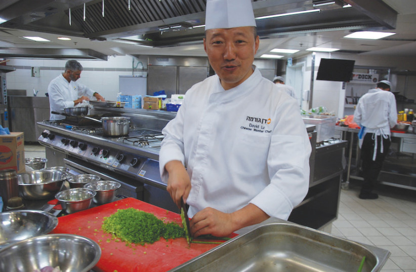 CHINESE MASTER CHEF David Lv at the Dan Gourmet Fine Arts Cooking Center in Tel Aviv last week. (photo credit: MEDIA LINE)