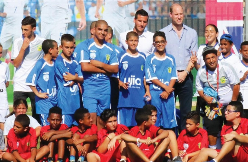 PRINCE WILLIAM poses with participants of The Equalizer program yesterday in Jaffa after their exhibition soccer game.  (photo credit: AVIV HAVRON)