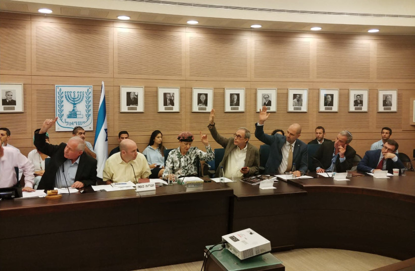 MKs voting in favor of the Pay for Slay bill Wednesday at the Knesset Foreign Affairs and Defense Committee June 27, 2018 (photo credit: COURTESY AVI DICHTER'S OFFICE)
