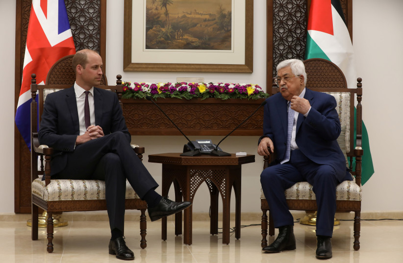Palestinian President Mahmoud Abbas gestures during his meeting with Britain's Prince William in Ramallah, June 27, 2018 (photo credit: ALAA BADARNEH/POOL VIA REUTERS)