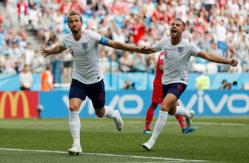 England's Harry Kane celebrates with Jordan Henderson after scoring their second goal against Panama, June 24, 2018 (photo credit: REUTERS/CARLOS BARRIA)