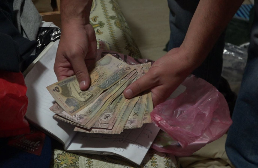 Money seized by the police and Shin Bet from a terrorist's family in east Jerusalem (photo credit: COURTESY ISRAEL POLICE)