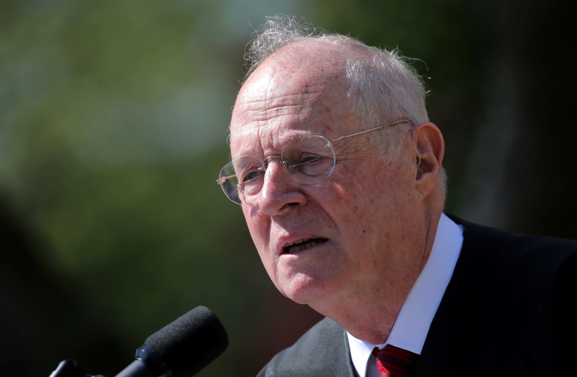 Supreme Court Associate Justice Anthony Kennedy speaks during a swearing in ceremony for Judge Neil Gorsuch as an associate justice of the Supreme Court in the Rose Garden of the White House in Washington, DC, U.S (photo credit: CARLOS BARRIA / REUTERS)
