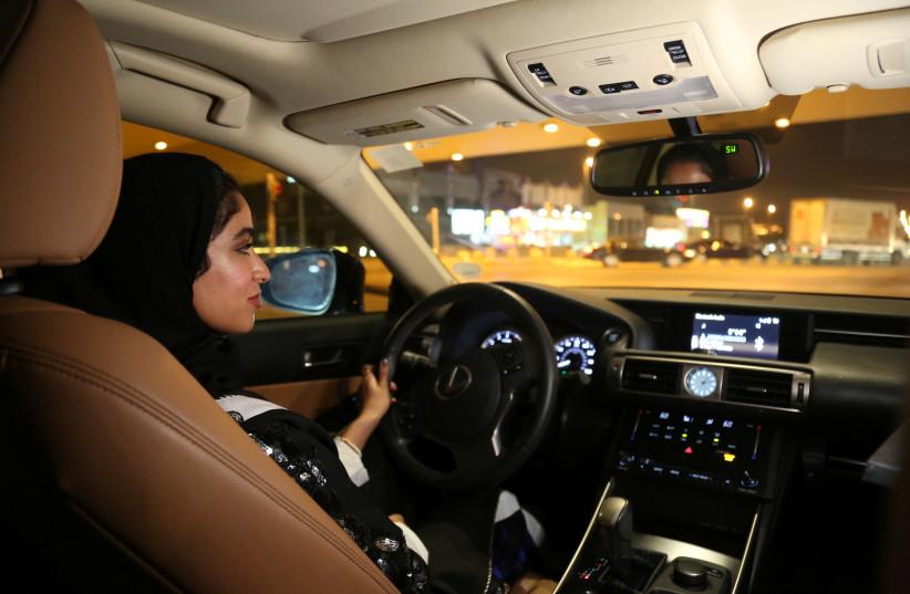 Majdooleen, who is among the first Saudi women allowed to drive in Saudi Arabia, drives her car in her neighborhood in Riyadh, Saudi Arabia June 24, 2018.  (photo credit: REUTERS/SARAH DADOUCH)