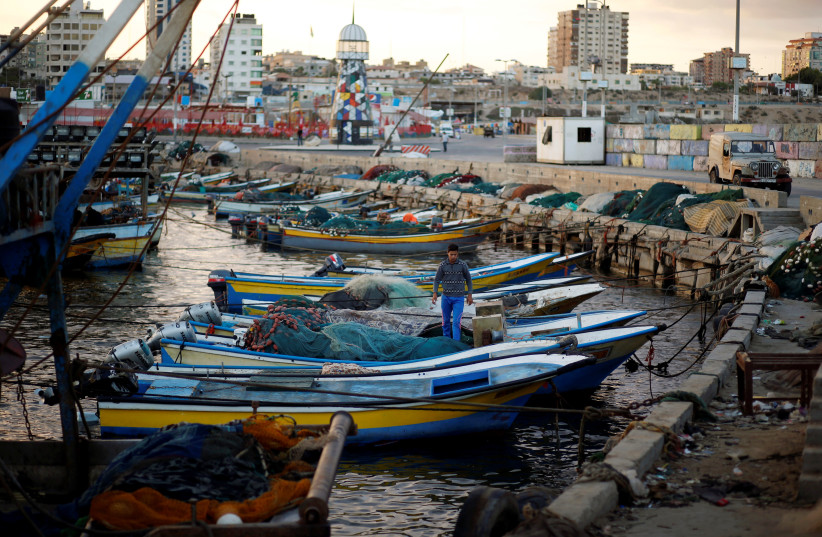 A Palestinian fisherman stands in a boat at the seaport of Gaza City September 26, 2016 (photo credit: REUTERS/MOHAMMED SALEM)