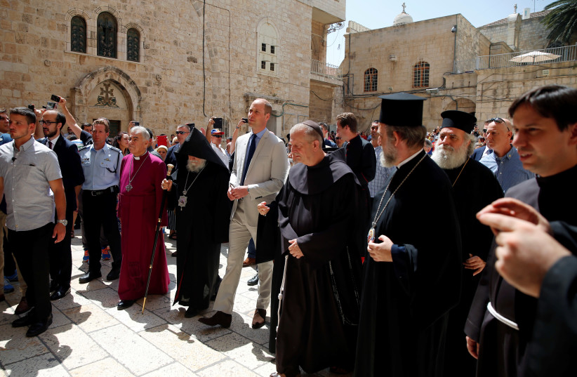 Britain's Prince William walks with religious leaders as he arrives for a visit to the Church of the Holy Sepulchre in Jerusalem's Old City, June 28, 2018 (photo credit: REUTERS/AMMAR AWAD)