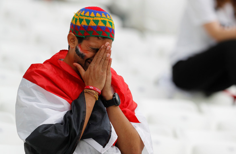 An Egypt fan looks dejected after his country's match vs Saudi Arabia at the World Cup, June 25, 2018 (photo credit: REUTERS/DARREN STAPLES)