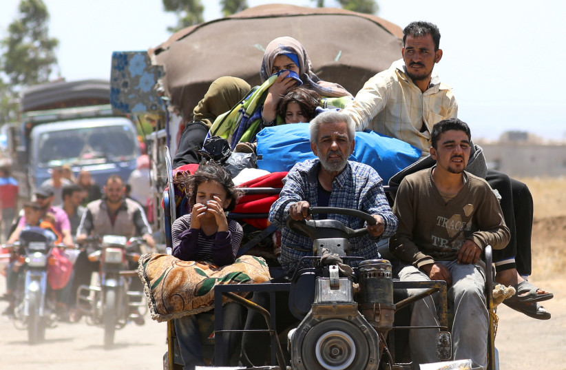 Internally displaced people from Deraa province arrive near the Golan Heights in Quneitra, Syria June 29, 2018. (photo credit: REUTERS/ALAA AL-FAQIR)