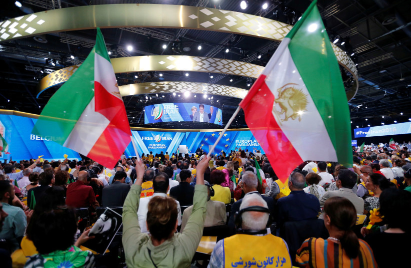 Supporters of Maryam Rajavi, president-elect of the National Council of Resistance of Iran (NCRI), attend a rally in Villepinte, near Paris, France, June 30, 2018. (photo credit: REUTERS/REGIS DUVIGNAU)