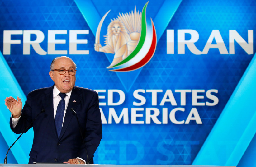 Rudy Giuliani, former Mayor of New York City, delivers his speech as he attends the National Council of Resistance of Iran (NCRI), meeting in Villepinte, near Paris, France, June 30, 2018 (photo credit: REUTERS/REGIS DUVIGNAU)