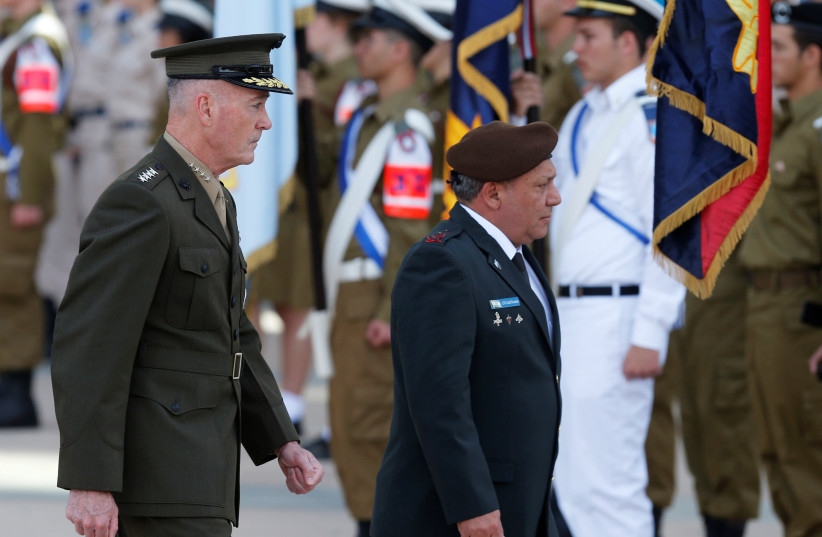 General Joseph Dunford (L), the Chairman of the U.S. Joint Chiefs of Staff, walks next to Israel's Chief of Staff Lieutenant-General Gadi Eizenkot, as they review an honour guard in Tel Aviv, Israel May 9, 2017. (photo credit: NIR ELIAS / REUTERS)