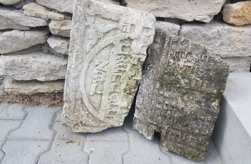 Jewish gravestone fragments found in a demolished cowshed in Klępie Górne, close to Kielce. (photo credit: BECKY BROTHMAN)