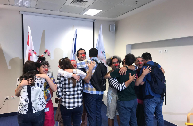 Yazidi Participants learn medical clowning (photo credit: FOREIGN MINISTRY)