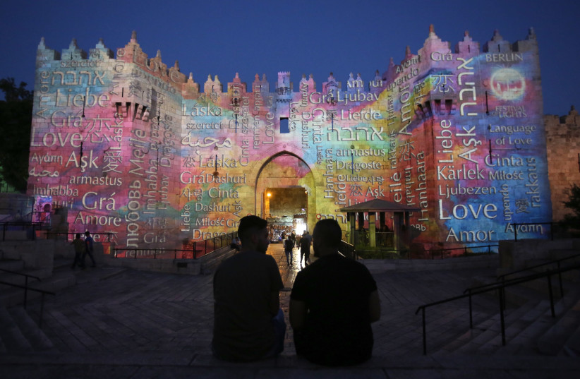 Damascus Gate, which leads to Jerusalem's Old City, is projected with the word 'love' in different languages in honor of the capital's 10th annual International Festival of Light, 2018 (photo credit: MARC ISRAEL SELLEM)