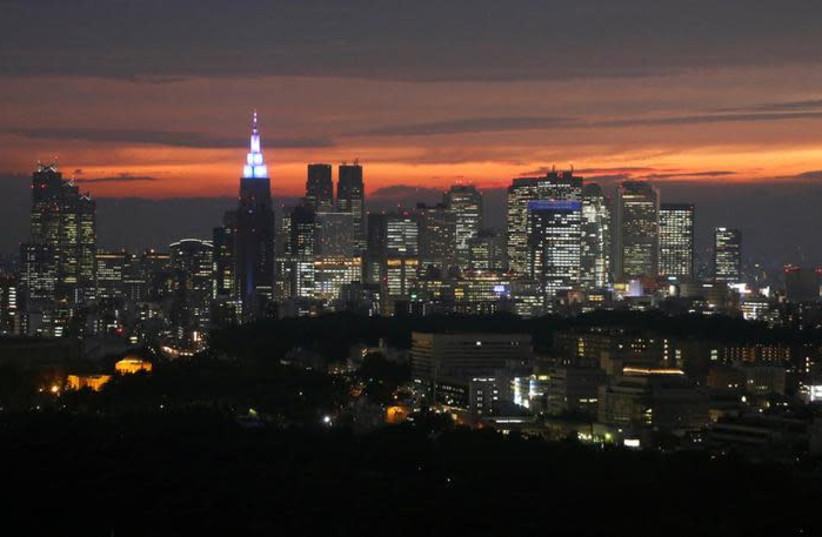 High-rise buildings are seen at the Shinjuku business district during sunset in Tokyo, Japan, May 31, 2018 (photo credit: REUTERS/TORU HANAI)