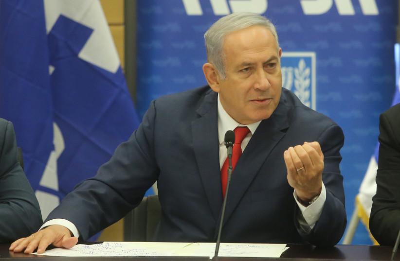 Prime Minister Benjamin Netanyahu gestures during a Likud faction meeting, July 2 2018 (photo credit: MARC ISRAEL SELLEM/THE JERUSALEM POST)
