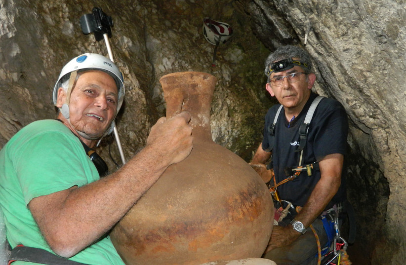 Dr. Danny Sion (right) of the Israel Antiquities Authority and  Dr. Yinon Shivtiel of Safed Academic College in the cave. (photo credit: OMRI GESTER/ISRAEL ANTIQUITIES AUTHORITY)