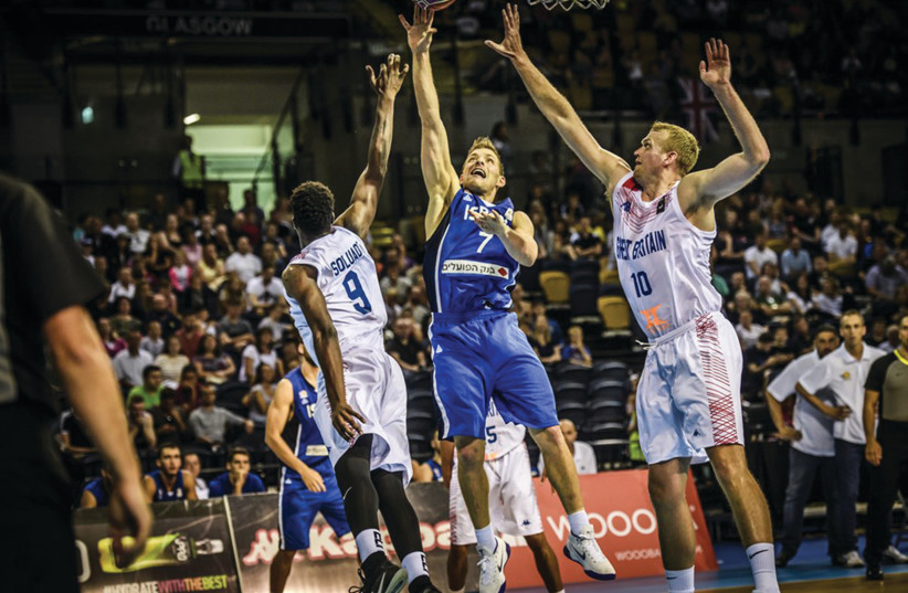 GAL MEKEL (7) helped propel Israel to a 67-59 victory over Great Britain on Monday night to earn a spot in the seconnd round of World Cup qualifying. (photo credit: FIBA EUROPE/ COURTESY)