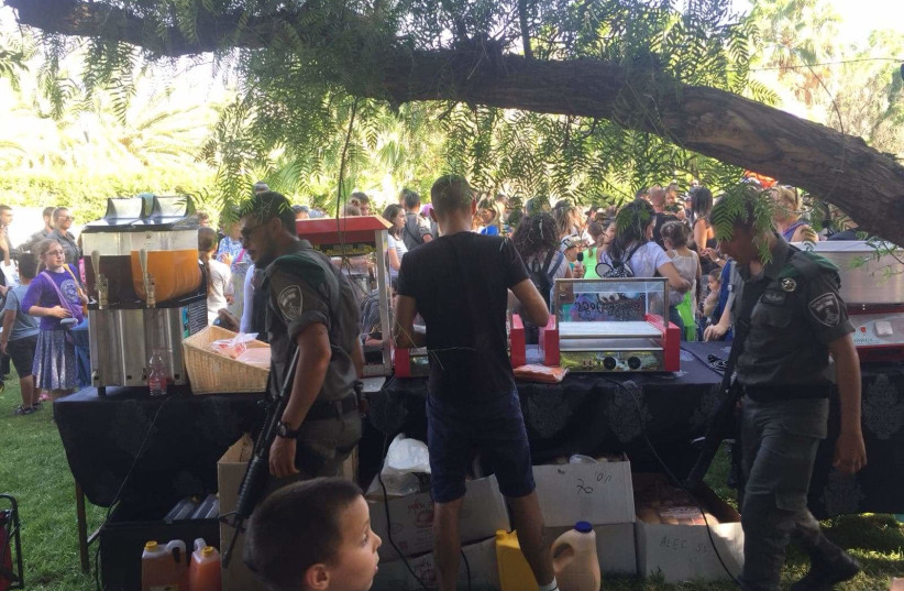 Children and parents from the Ma'aleh Adumim community celebrate the birthday of six-year-old Matanel (photo credit: NAOMI SINGER FRIST)