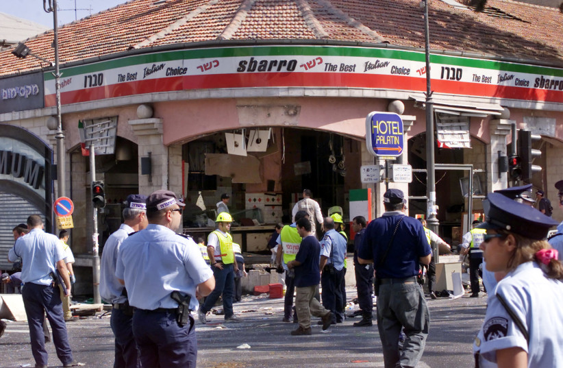 A gaping hole is left in the shop front of the Sbarro pizzeria after a suicide bombing, August 9, 2001 (photo credit: REUTERS)