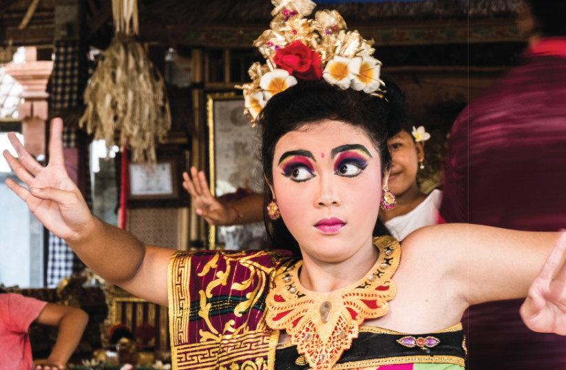 A YOUNG Balinese dancer performs in traditional dress (photo credit: YOAV DIKSTEIN)