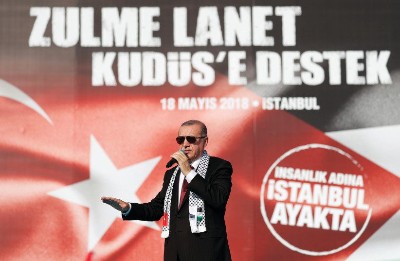 TURKISH PRESIDENT Tayyip Erdogan delivers a speech during a protest against the recent killings of Palestinian protesters on the Gaza-Israel border and the US embassy move to Jerusalem, in Istanbul, Turkey on May 18. (photo credit: REUTERS)