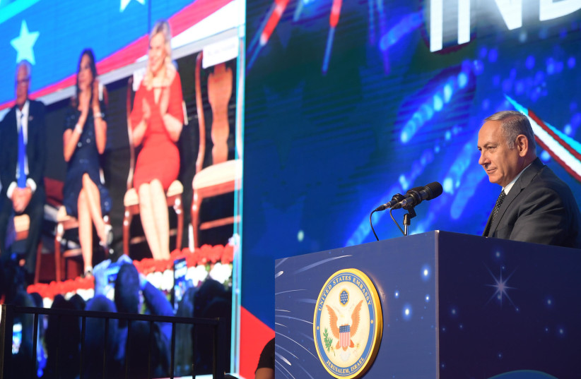 Prime Minister Benjamin Netanyahu speaks at an American Independence Day reception, July 3, 2018 (photo credit: AMOS BEN-GERSHOM/GPO)