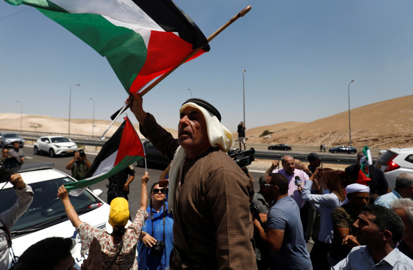 Palestinians attend a protest against Israel's plans to demolish the Bedouin village of Khan al-Ahmar, in the West Bank July 6, 2018. (photo credit: MOHAMAD TOROKMAN/REUTERS)