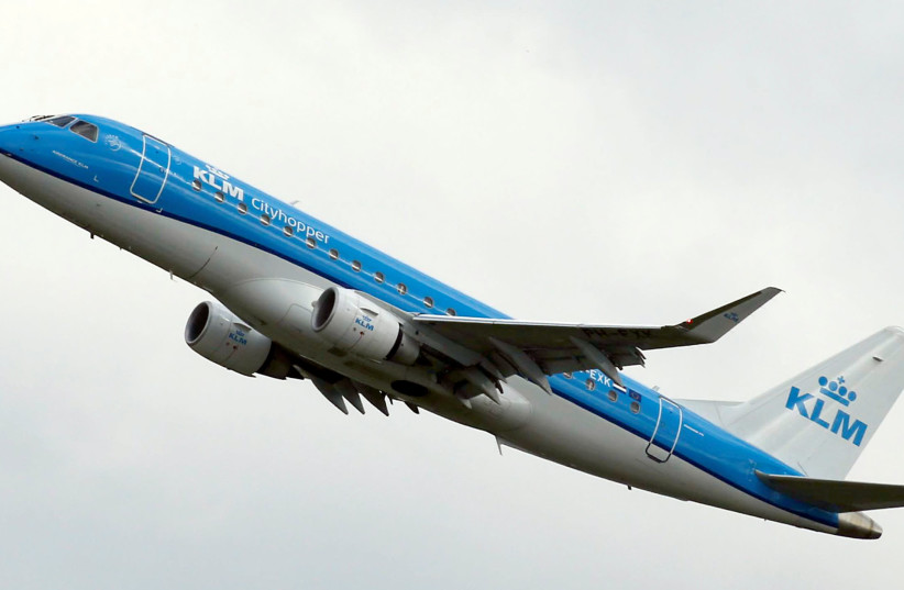 A KLM commercial passenger jet takes off in Colomiers near Toulouse, France, October 19, 2017 (photo credit: REUTERS/REGIS DUVIGNAU)