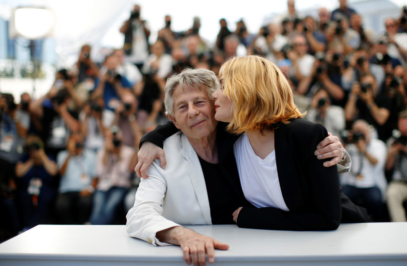 """Emmanuelle Seigner kisses Director Roman Polanski at a photocall for the film """"Based on a True Story"""" at the 70th Cannes Film Festival (photo credit: REUTERS/STEPHANE MAHE)"""