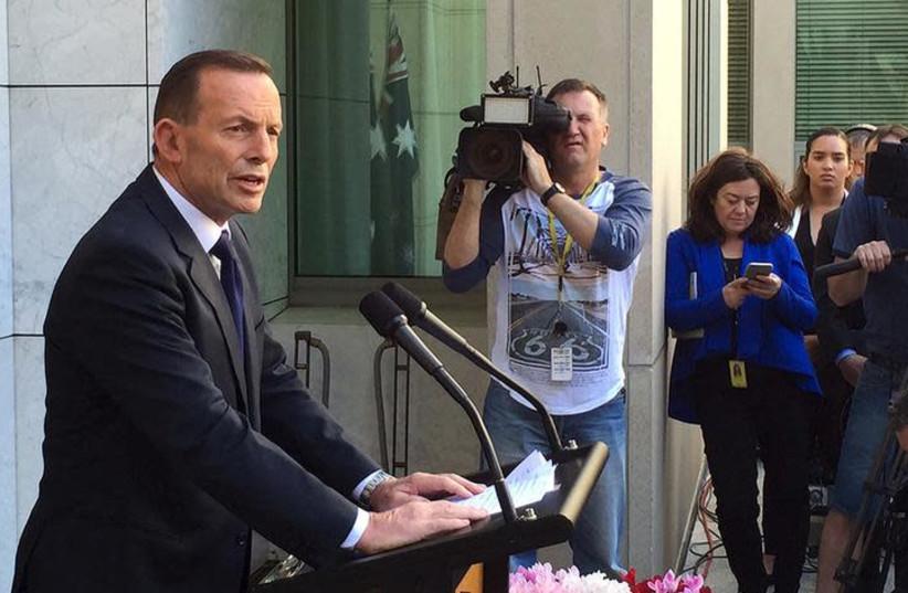 Former Australian Prime Minister Tony Abbott speaks to the media at Parliament House in Canberra, September 15, 2015. (photo credit: REUTERS/MATT SIEGEL)