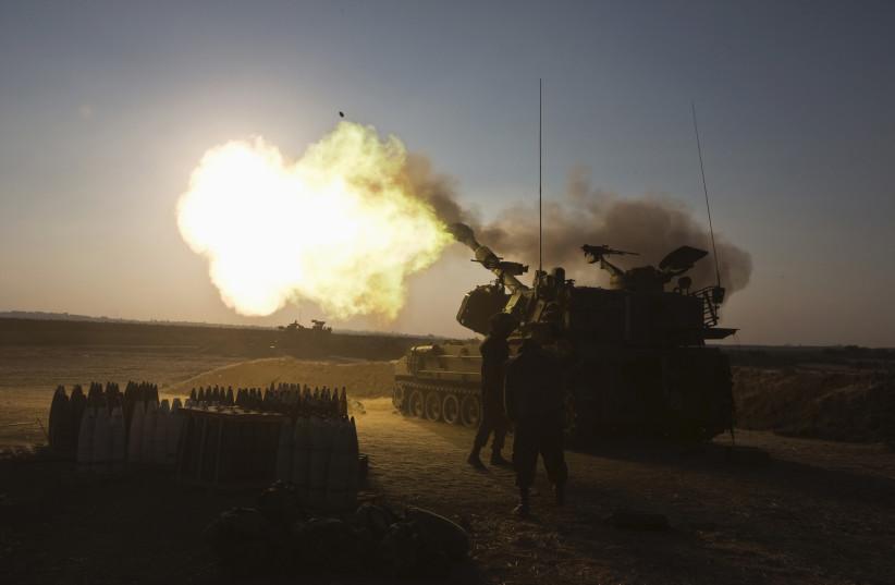 An Israeli mobile artillery unit fires towards the Gaza Strip July 21, 2014 (photo credit: REUTERS/NIR ELIAS)